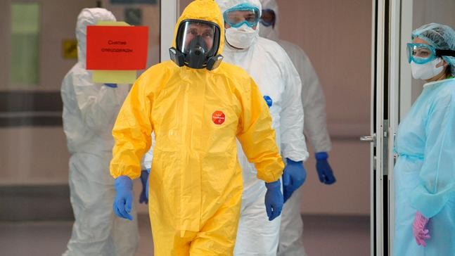 Image result for Russian President Vladimir Putin, wearing a yellow protective suit, visits a hospital for patients with suspected coronavirus in New Moscow on March 24, 2020. (Alexei Druzhinin